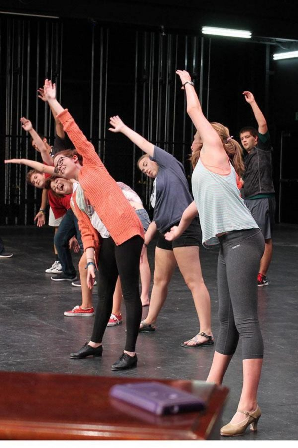 The+cast+of+Singing+in+the+Rain+warms+up+before+practicing+their+tap+dancing+skills.+Sophomore+Alexa+Clinton+shared+that+the+tap+dancing+for+this+year+is+much+different+from+last+year.+%0A%22I+re-taught+everyone+the+tap%2C+which+is+now+changed%2C%22+Clinton+said.+%22This+is+what%27s+going+to+take+out+a+lot+of+our+energy.%22