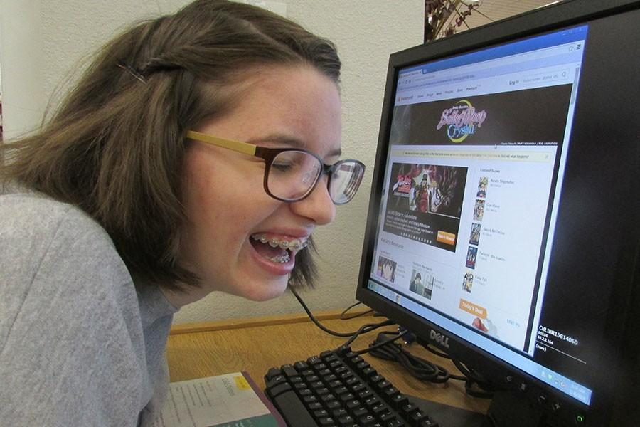 Laughing%2C+Allison+McCarty+fangirls+about+anime+on+the+Crunchyroll+website.+McCarty+usually+goes+on+the+app+after+school+to+catch+up+on+her+favorite+anime+shows+while+working+on+her+homework.+%E2%80%9CAnime+is+so+much+fun+and+I+love+watching+it%2C%E2%80%9D+McCarty+said.+%E2%80%9CIt%E2%80%99s+really+nice+to+sit+down+and+enjoy+watching+something+that+you+like+to+spend+time+on.%E2%80%9D