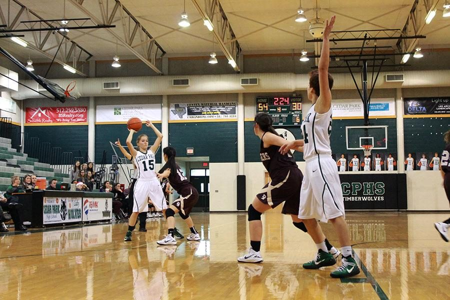 Playing+at+the+Timber+Dome+basketball+court%2C+junior+guard+Jennifer+Stallings+aims+the+ball+at+senior+forward+Lexus+Ojeda+during+the+Dripping+Springs+game+on+Dec.+19.+All+three+teams%2C+varsity%2C+JV+and+freshman+beat+Drip.+%E2%80%9CIt+was+really+a+good+feeling+knowing+that+all+our+teams+beat+Dripping+springs%2C%E2%80%9D+Stallings+said.+%E2%80%9CIt+just+shows+how+passionate+we+are+of+the+game%2C+and+what+we+all+put+into+the+sport.%E2%80%9D