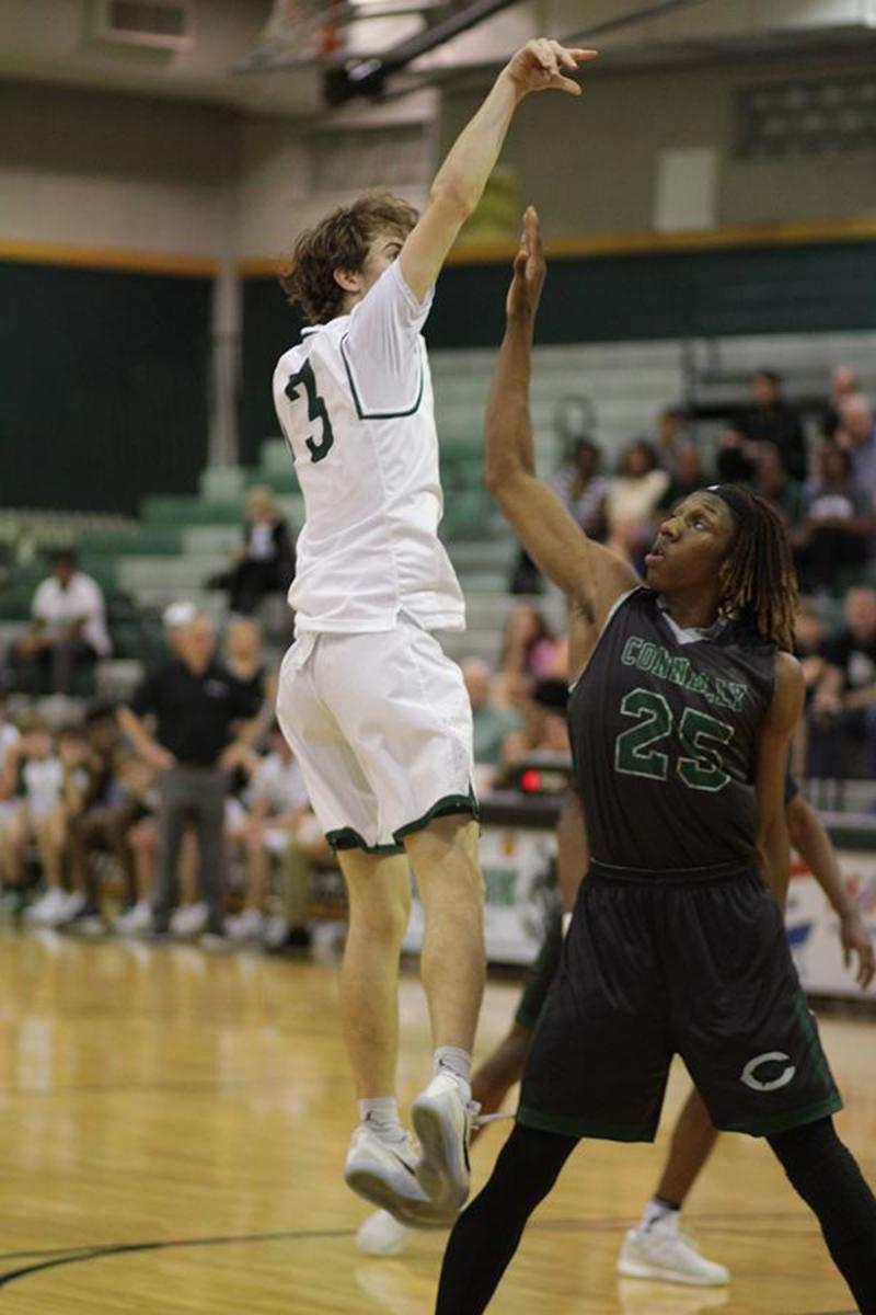 Junior Eric Weeks hits a buzzer-beater to beat Connally on Feb. 7 at the Timberdome