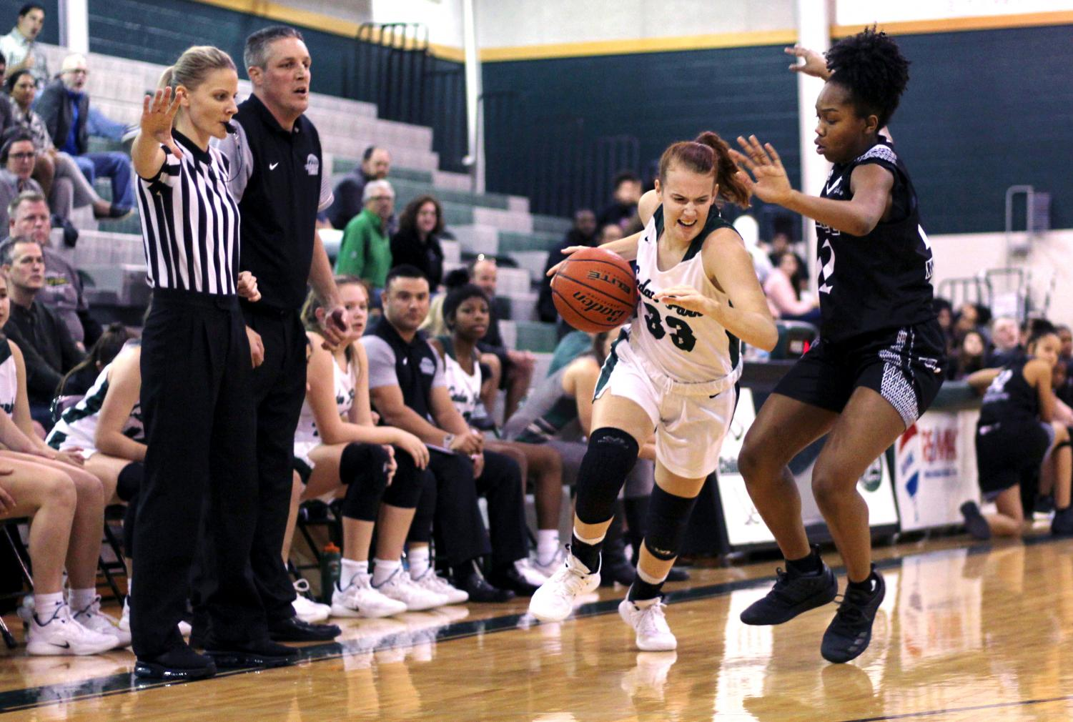 Hustling toward the basket, senior Callie Copeland powers thorugh 6A Cibolo Steele's defense on Nov. 30. Copeland was the team's captain and played shooting guard, where her primary goal was to score points for the team.