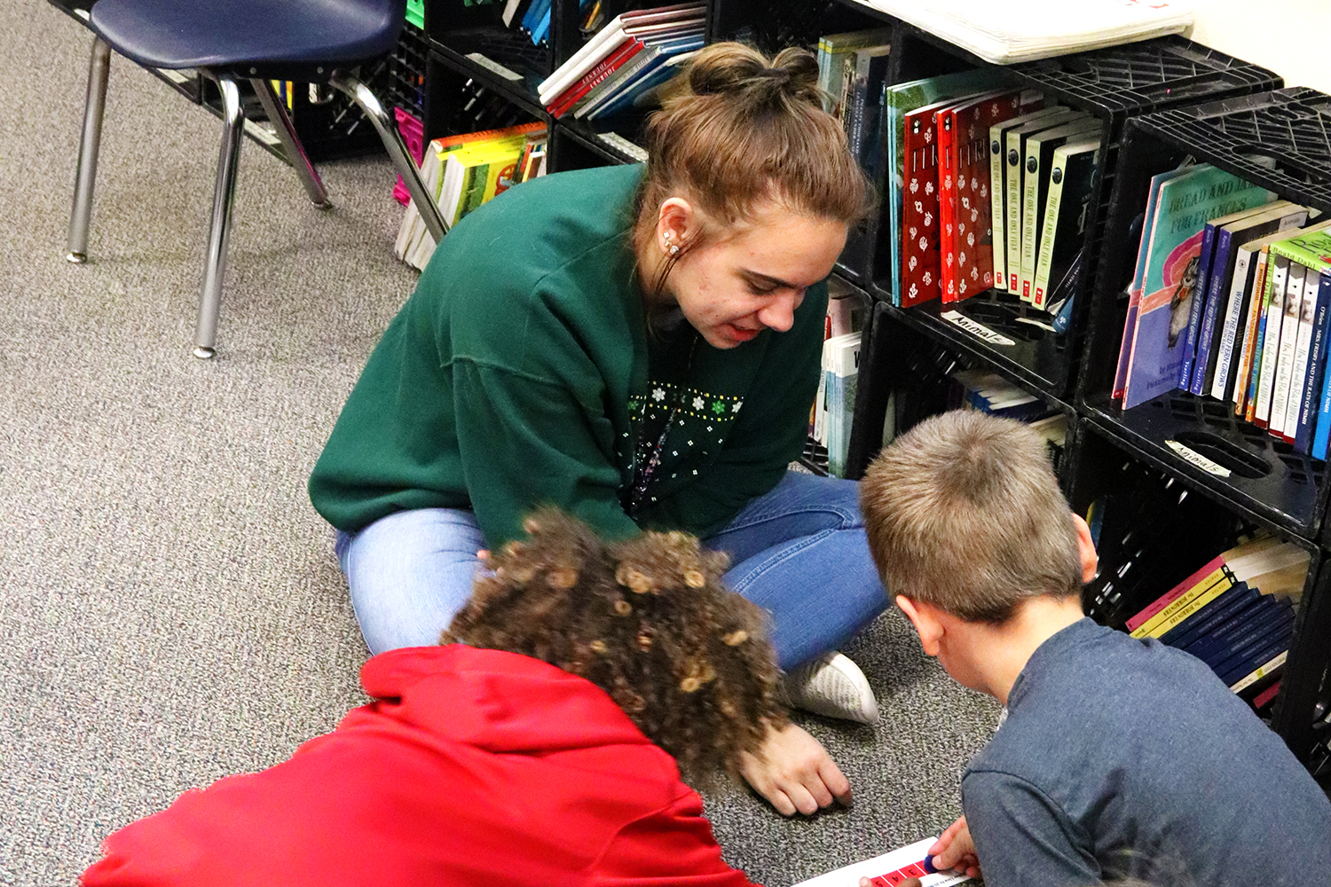 "Senior Sarah Bodnar works with students at Westside Elementary as part of her Ready Set Teach program. ""Working with the kids was a blast,"" Bodnar said. ""It was frustrating sometimes, but was also really rewarding to get to experience their personalities growing and developing."