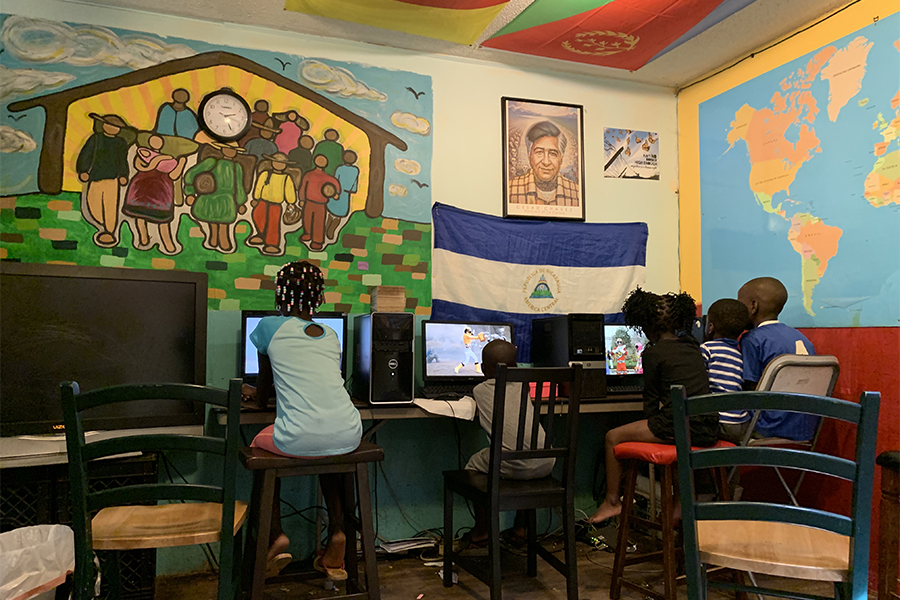 Residents' children take a break to play games on the computers before dinner at Casa Marianella.