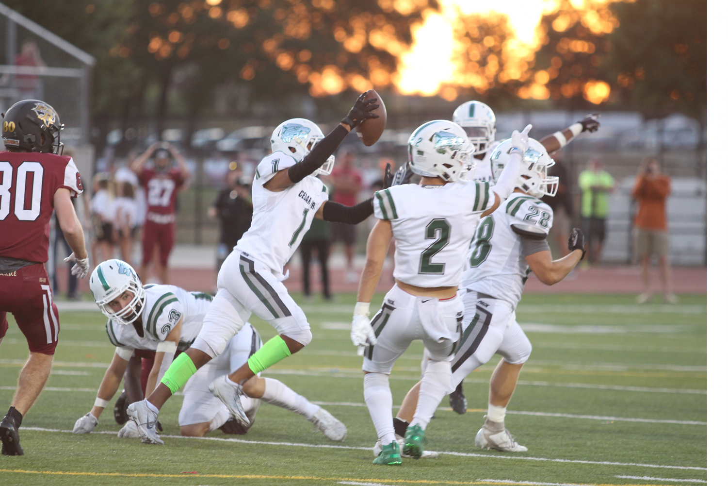 Senior CB Caden Combs celebrates with the defense after picking off a pass on Sept. 27 against Rouse at Bible Stadium. The defense got numerous turnovers against Rouse, thus leading to short fields and points for the offense.