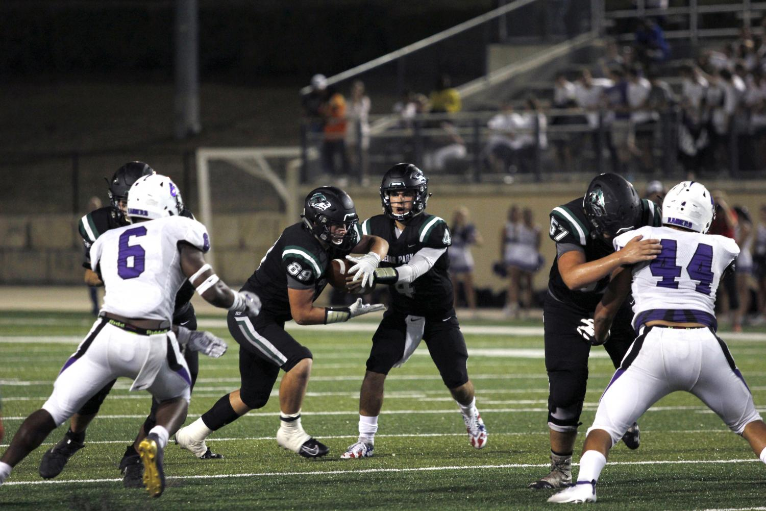 QB Ryder Hernandez runs a run-pass option with RB Jonathan Stockwell on Sept. 9. This game, the offensive line gave Hernandez time to sit in the pocket and thow, leading to highlight-reel plays.