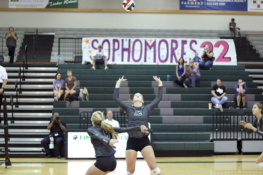 Senior Olivia Meyer sets the ball in a game on Aug. 22 at the volleypalooza at Cedar Park. After going through a terrible injury that had hindered her participation in the sport since eighth grade, Meyer recently returned to playing the sport she loves.