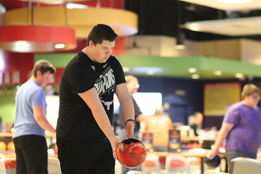 "Focusing on his shot, senior Kyle Redfern practices for the team's first ever tournament. Redfern has been on the bowling team for three years and is a starter on varsity.  ""I feel really good about the team this year,"" Redfern said. ""We have a really strong group of five that we feel can really compete, so we're expecting big things this year"""
