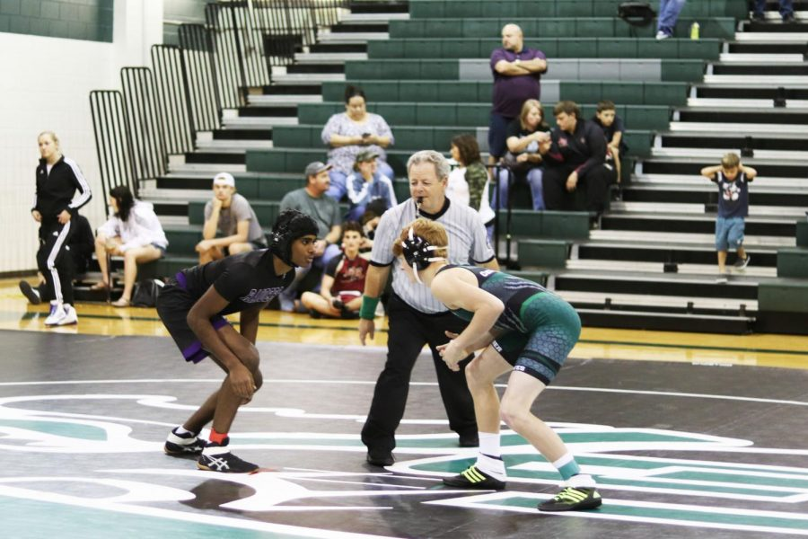 Freshman+wrestler+JJ+Lovell+gets+ready+to+take+on+an+opponent+during+the+Capital+Classic+Tournament+on+Nov.+22-23.+This+was+the+third+tournament+of+the+season+for+the+wrestling+team%2C+with+five+members+earning+top+ranks%2C+and+senior+captain+Cassie+King+named+Capital+Classic+Varsity+Girls+110lb+Champion.+%E2%80%9CAfter+I+won%2C+getting+my+hand+raised+was+one+of+the+best+feelings+because+winning+a+tournament+against+25+other+girls+just+shows+finally+how+much+work+I%E2%80%99ve+been+putting+into+this+sport+by+dieting+well%2C+training+hard+and+constantly+staying+disciplined%2C%E2%80%9D+King+said.+%E2%80%9CI+ran+and+gave+my+coach+a+hug+%5Bafter+the+match%5D+because+without+him+I+wouldn%E2%80%99t+have+gotten+this+far.%22