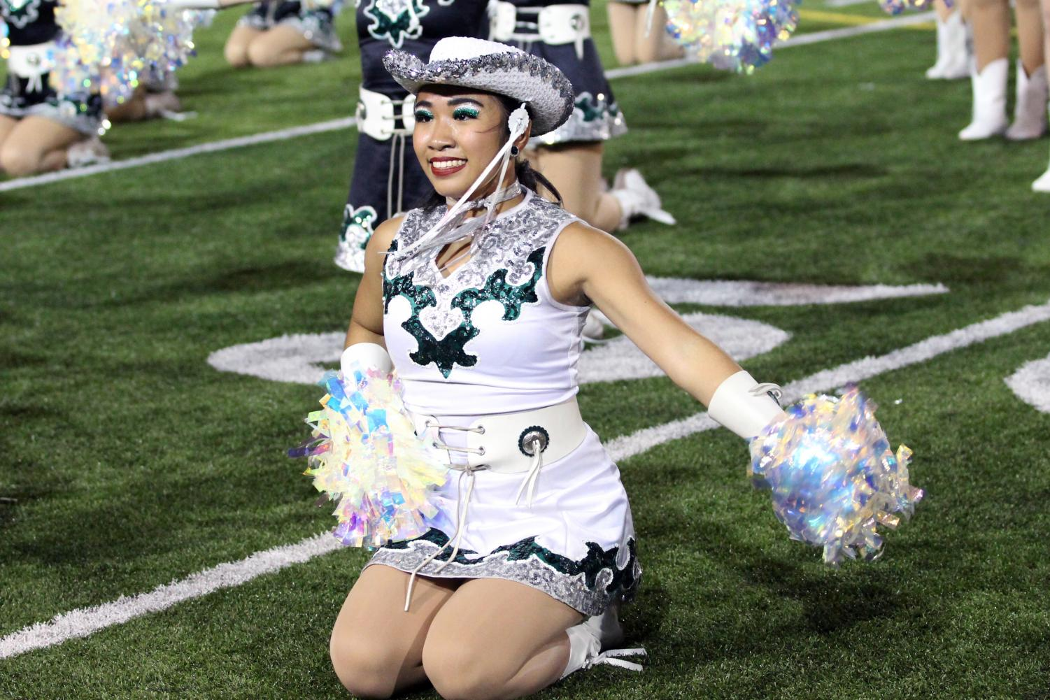 Sitting on the Gupton stadium football field on Sept.27, junior Celebrities captain Rylee Tonacao performs at halftime with fellow team members. When Tonacao received the news that she was chosen as the 2019-2020 Celebrities dance captain, she was shocked.