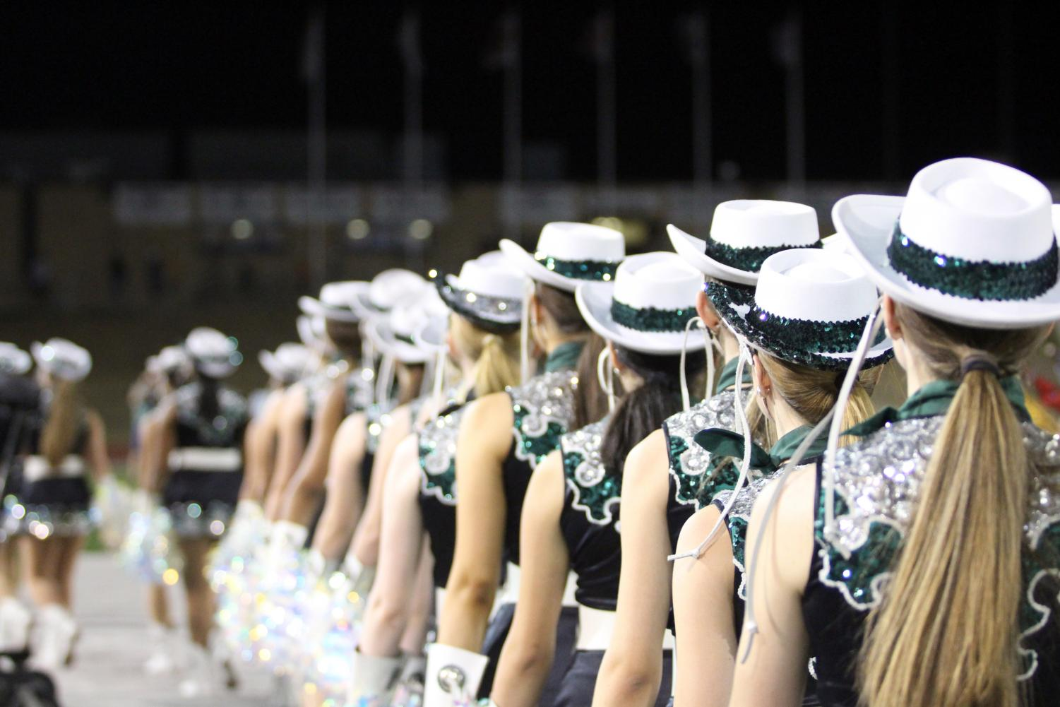 """The 2019-2020 Celebrities line up on the football sidelines after their halftime performance on Sept. 27. First year auditionee, freshman Emerald Charity Cox was able to earn a spot on the 2020-2021 Celebrities team. She said that throughout the four days of the process, her feelings varied. """"My feelings definitely changed as each day came and went,"""" Cox said. """"I was feeling excited on Monday, but on Thursday I was feeling a lot more nervous, [but] I was still feeling confident."""""""
