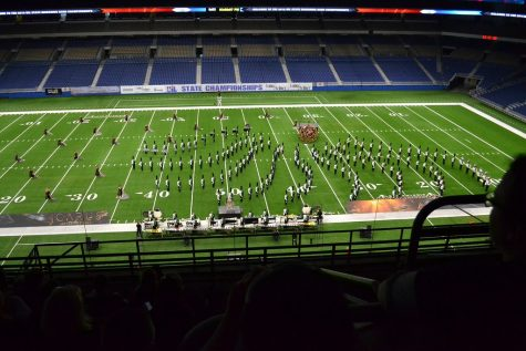 Filling the dome with sound, the Cedar Park High School band performs at the UIL State Championships. They won their third consecutive state championship on November 5.