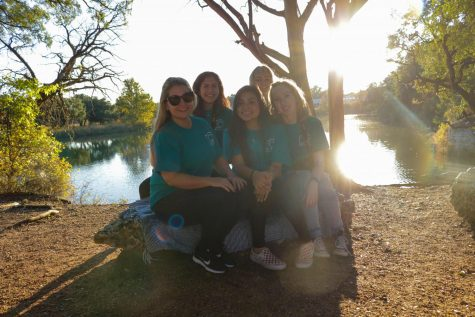 "Photography club officers and sponsor pose at Brushy Creek Park during their community service event. Senior club officer Cally Hall said she found the opportunity very enriching. ""It was rewarding to take the family photos, I enjoyed knowing that I was a part of making sure these families have memories to cherish forever,"" Hall said. ""I was afraid I would be shy or awkward taking photos of people I don't really know, but it went a lot more smoothly than I anticipated and was actually pretty fun."""