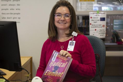 CPHS Librarian, Debby Barnes poses with a copy of