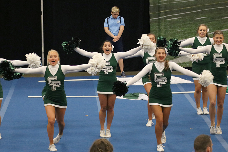 """Varsity cheerleaders perform during the cheer regional competition on Oct. 17. After regionals, the team moved to the state competition where they placed fifth. """"We know that fifth is in state is still an awesome rank, but just to know that our routine could've been better is still [disappointing],"""