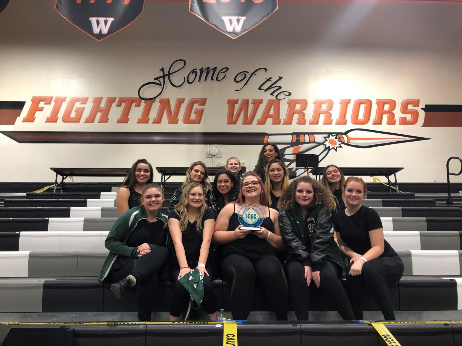 Containing their excitement, color guard poses for the camera after winning first place.