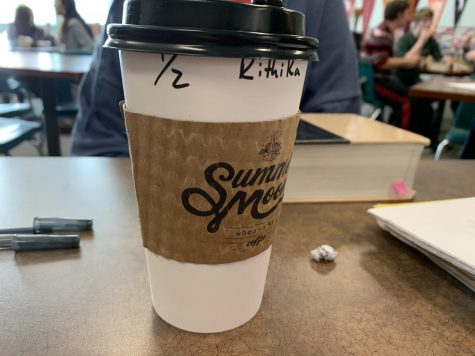 Coffee cup is pictured in a classroom. There are many addictions in society today. Drugs, alcohol and now one that is quiet, but still relevant; caffeine. According to Medical News Today, heavy use of caffeine can cause nervousness, anxiety, jitteriness, sleep problems, gastrointestinal disturbances, tremors and increased heart rate. So while students struggling to balance their busy lives resort to a caffeinated beverage, they are actually putting themselves at risk of something much worse than low energy or sleepiness.