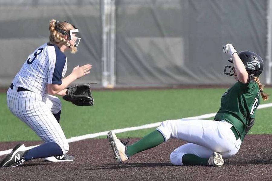 """Sliding into third base, senior outfielder Katy Kahlich gets into better scoring position for the batter. Kahlich has been on the varsity softball team for four years. """"It's just disappointing knowing we have a lot of talent and a lot of us seniors don't get the senior experience,"""" Kahlich said. """"It's upsetting just not experiencing not enjoying our final season."""""""