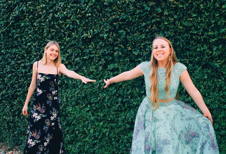Julia+Meyer+and+Kendee+West+practice+social+distancing+while+having+their+own+senior+prom+at+The+Oasis.+%E2%80%9CMy+sweet+family+helped+me+get+ready+and+my+sister+took+pictures+of+me+and+my+best+friend+Julia+and+we+just+talked+and+laughed%2C%E2%80%9D+West+said.+%E2%80%9CIt+wasn%E2%80%99t+exactly+how+I+imagined+senior+prom%2C+but+I+was+happy+that+I+could+still+spend+time+with+my+best+friend+even+from+6+feet+apart.%E2%80%9D