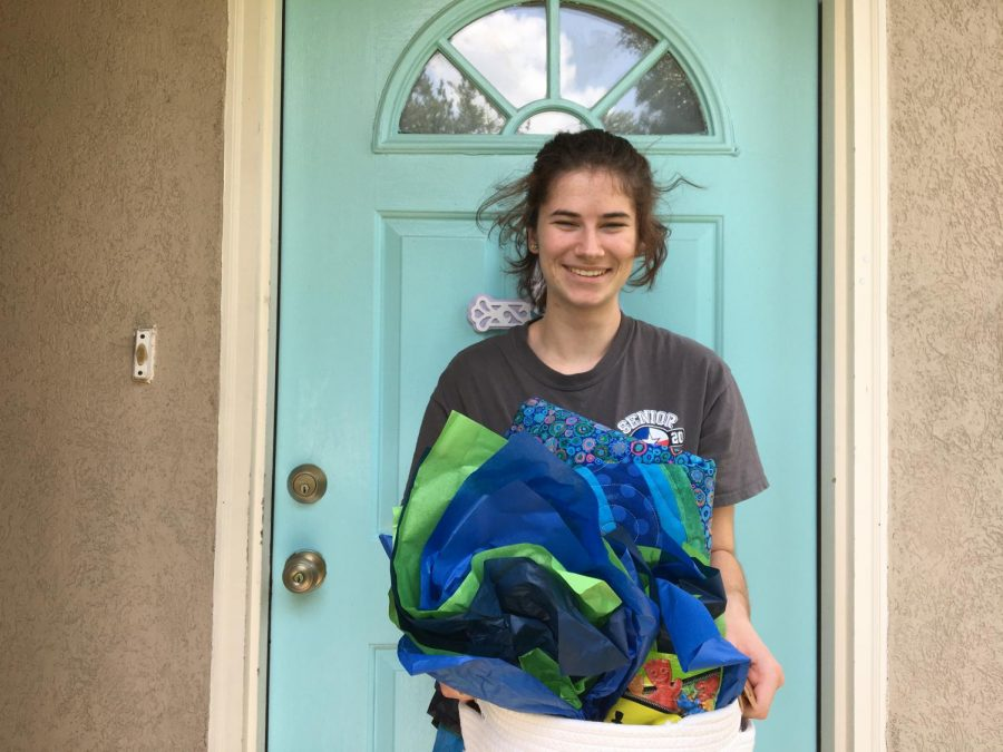 """Holding her basket of gifts, senior Sarah Rodriguez thanks her adoption family. """"I got adopted through my church,"""" Rodriguez said. """"I am so thankful for the kind woman who chose me and thought about how stressed we all are right now."""""""