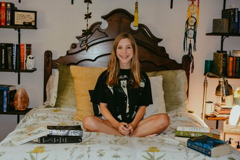 "Posing in her room, senior Kieren Garner smiles while being surrounded by books. Garner plans to major in English at Texas State in the fall. ""I genuinely cannot wait to pursue it and learn more in college. It's going to be a whole new world full of new opportunities and growth,"" Garner said."