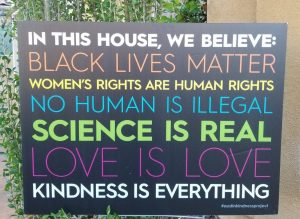 This sign was created by a group of Wisconsin women. Now the sign is a nationwide symbol for justice.