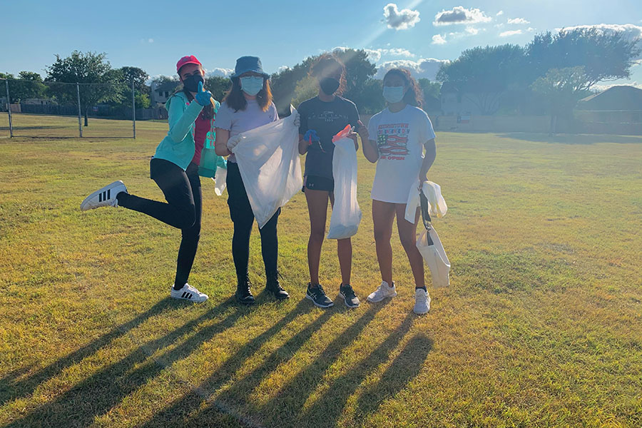 Members of the environmental club have fun saving the environment in small ways such as cleaning up trash at parks. This time, the club went to Milburn Park.