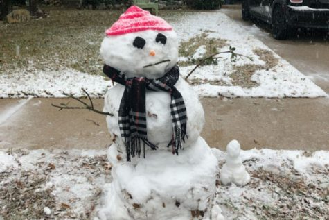"""Junior Nathan Inman makes a snowman with his family. Despite it being really cold, Inman said that it was worth going outside because Texans might not experience this again.  """"It was so nice to experience creating a snowman, and enjoying the snow here in Austin, instead of traveling somewhere like New York for the snow,"""" Inman said."""