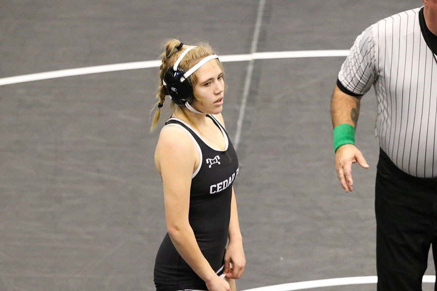 """Stepping out into the mat, sophomore Erika Peterson prepares for her wrestling match for the district tournament last year. Peterson was hoping to pass district and then go to regionals, however because of the pandemic the 2019-2020 season was cut short. """"I was pretty excited to go to regionals,"""" Peterson said. """"I was glad that COVID hadn"""