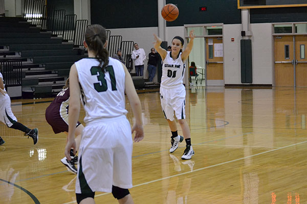 Junior Rachel Pokorney passes the ball to senior Tahlea Holst during the Dripping Springs game on Dec. 13, which CP won 54-34. Photo by Sabrina Lee.
