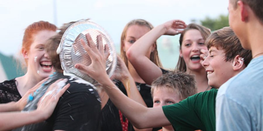 During+the+introductory+FFA+meeting+to+kick+off+the+2013-14+school+year%2C+senior+Ryan+Prindle+gets+pied+in+the+face+by+freshman+Kyle+Diclemente+as+part+of+the+group+bonding+activities.