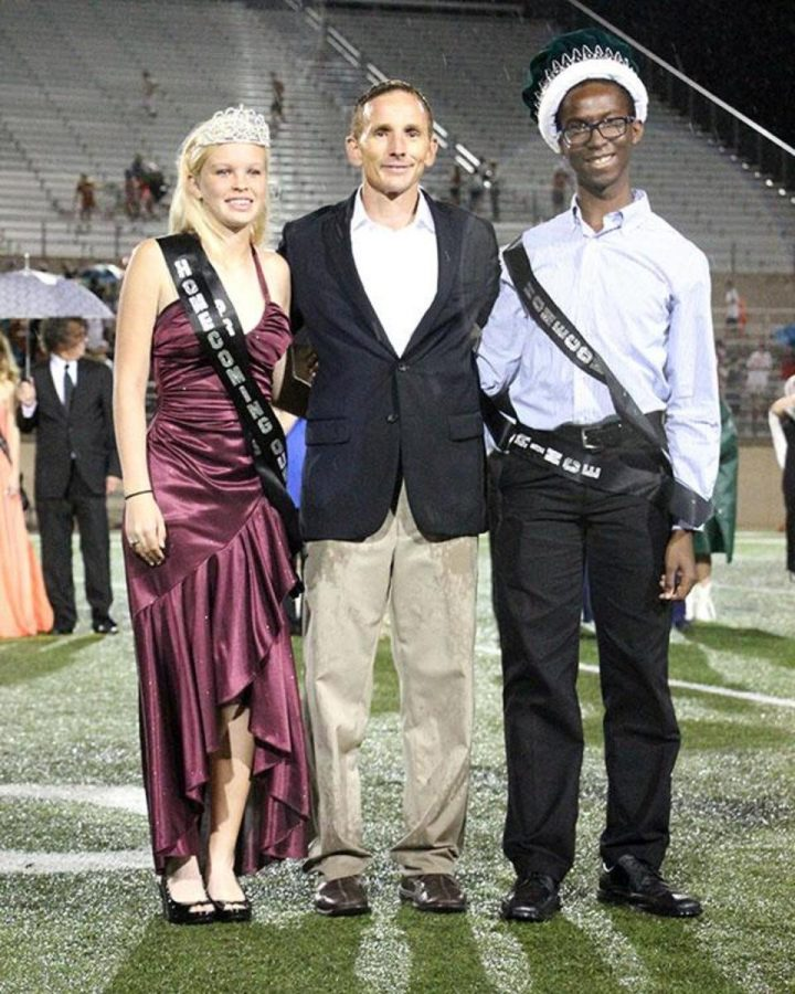 Senior Queen Kat Cuthbertson and senior King Godson Iheanacho  were crowned by Principal John Sloan on Sept. 12 during a rainy half-time.