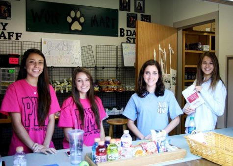 DECA members run the Wolfmart every day during both lunches. Left to Right: seniors Alyssa Cepeda, Christina Lanzoni, Katie Wane, and Christina Land