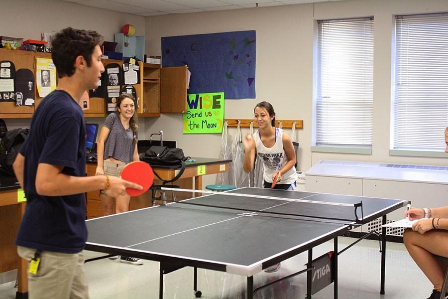 During+a+meeting%2C+junior+Jenna+Lipscomb+sets+up+the+next+round+for+junior+Layth+Eldaher+to+receive+for+the+win+on+Oct.+22.++Ping+pong+member+Maddy+Davis+told+us+about+the+bracket+between+Lipscomb+and+Eldaher.+%E2%80%9CThe+game+was+really+intense%2C+she+was+about+to+serve+and+she+only+needed+one+more+point+to+win+the+game%2C%E2%80%9D+Davis+said.%0A