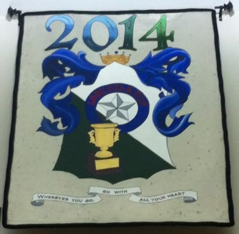The school's crest flags hang on the upper walls of the library.