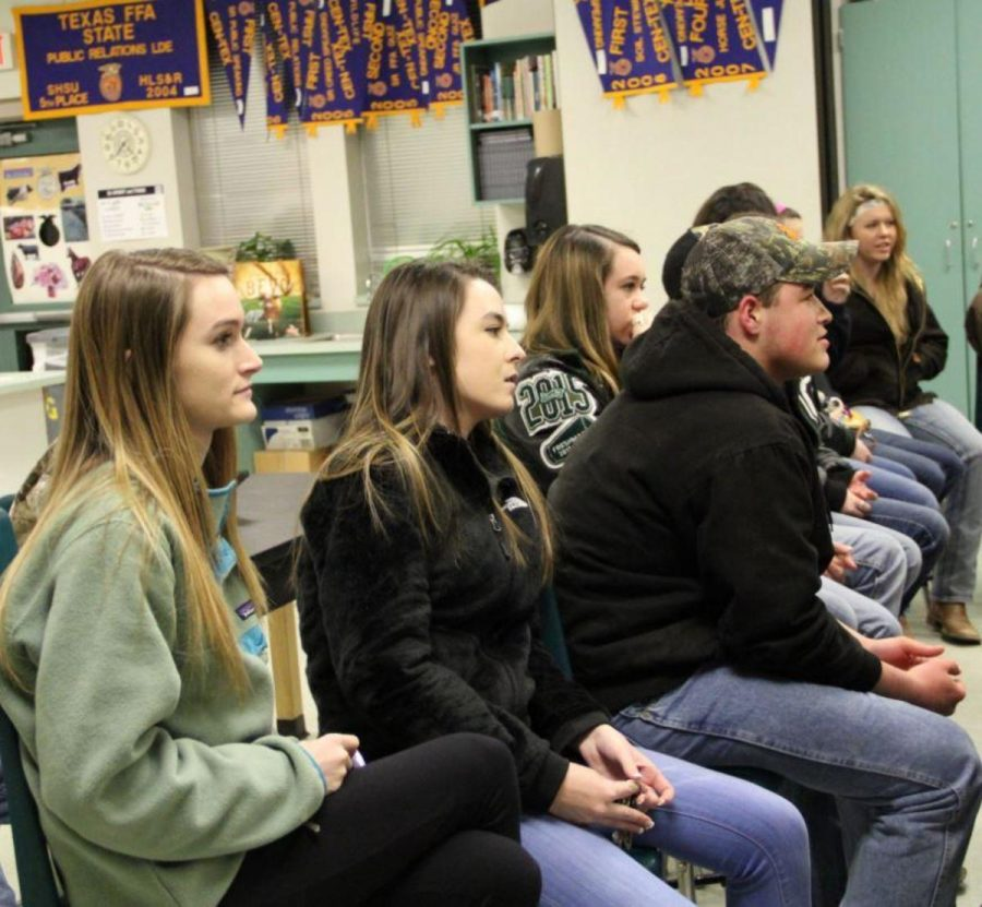 """Senior Emily Miller, pictured on right, sits in an FFA meeting pertaining to the County Show. """"[The show] was fun; mainly it's good experience because through FFA, I've gained a lot of maturity and patience,"""" Miller said. """"I actually prepared my animal more than myself."""""""
