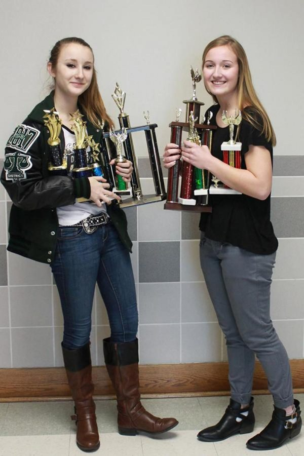Sophomores+Morgan+Grosch+and+Macalah+Thomas+have+both+recently+qualified+for+TFA+State%2C+and+are+very+excited+about+the+upcoming+competition+and+to+possibly+bring+home+debate+trophies+like+the+ones+they+are+holding.+%22I%E2%80%99m+more+excited+for+the+competition+than+I+am+nervous%2C%E2%80%9D+Grosch+said.+%22It%27s+a+big+deal+for+sophomores+to+qualify.%22