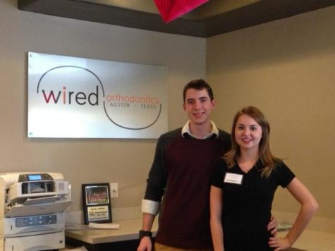 Seniors York Westenhaver and Lexi Rima pose in front of the Wired Orthodontics office.