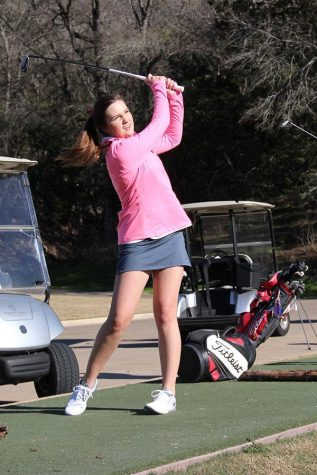 """Sophomore Addison English swings her club, practicing for upcoming golf tournaments.  """"I like how golf is an individual sport, but at the same time you play as a team,"""" English said. """"We play off of each other and it's good for bonding."""""""