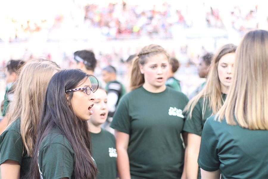 During the Rouse vs. Cedar Park game, senior Rayna Mazumadar and the rest of the CPHS choir sang the National Anthem. Mazumadar was one of the 12 girls that is competing in Regionals.
