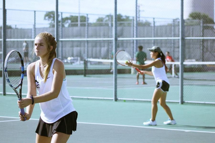 Focused and ready,  freshmen Kylee Ramsey and senior Emily Zhao put their game faces on for an October tournament.  All the hard work put into team practices comes into play during competition matches.  Though the fall season is over, the team continues their work in the spring season.