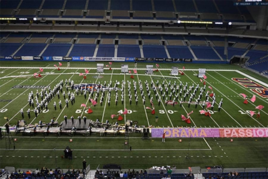 Students moving left and right, blowing into their instruments. Others are dressed in pink waving their flags in the air and all one can feel is the magic that muisc brings echoing in the wind. CP takes the stage, or in this case the field once again on Nov. 4 in the State Championship. This is a screenshot taken of the Band performing. Courtsety of the CPHS website