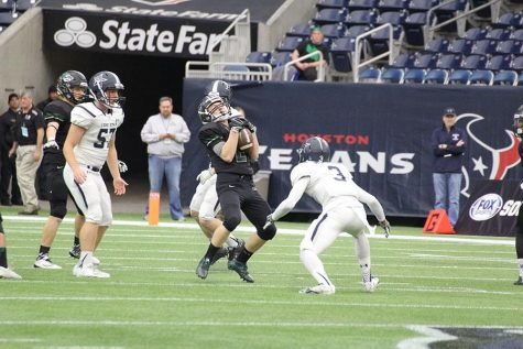 Senior Willie Richter catching a punt at the state game on Dec. 19.