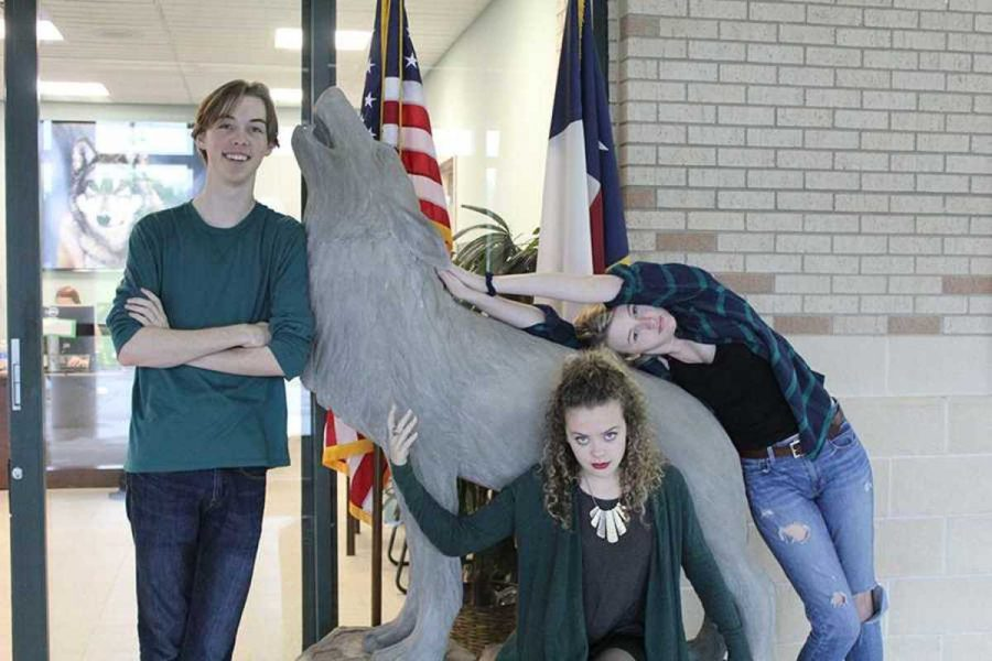 The three newspaper seniors, Jacob Herrick, Collyn Burke and myself, pose by the wolf at the front of the school.