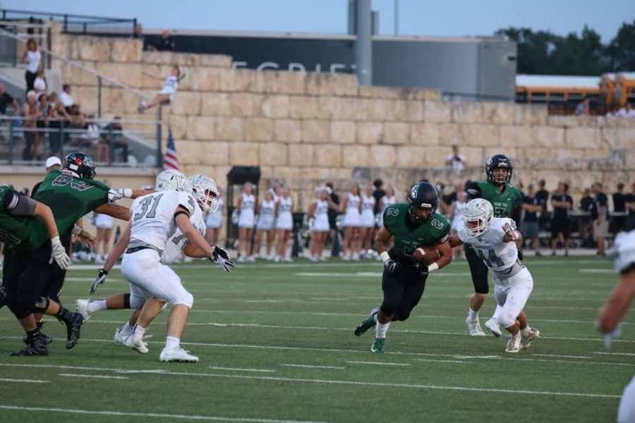 Senior+Omar+Alzer+carries+the+ball+through+a+group+of+Viper+defenders+at+Gupton+Stadium+on+Sept.+2.+%22The+entire+game+our+offense+was+struggling+in+the+run+game%2C%22+Alzer+said.+%22Once+I+started+hitting+the+holes+that+my+offensive+line+was+making+for+me+and+fighting+for+what+I+could+get%2C+our+offense+started+rolling.%22+