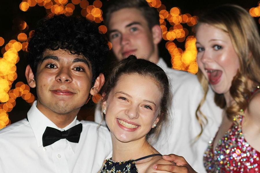 Junior+Eduardo+Almazan+and+Sophomores+Emma+Weddell%2C+Seth+Mehalic%2C+and+Kelsey+McFarland+at+%22Starry+Night%22+themed+homecoming+dance+on+Sept.17.+
