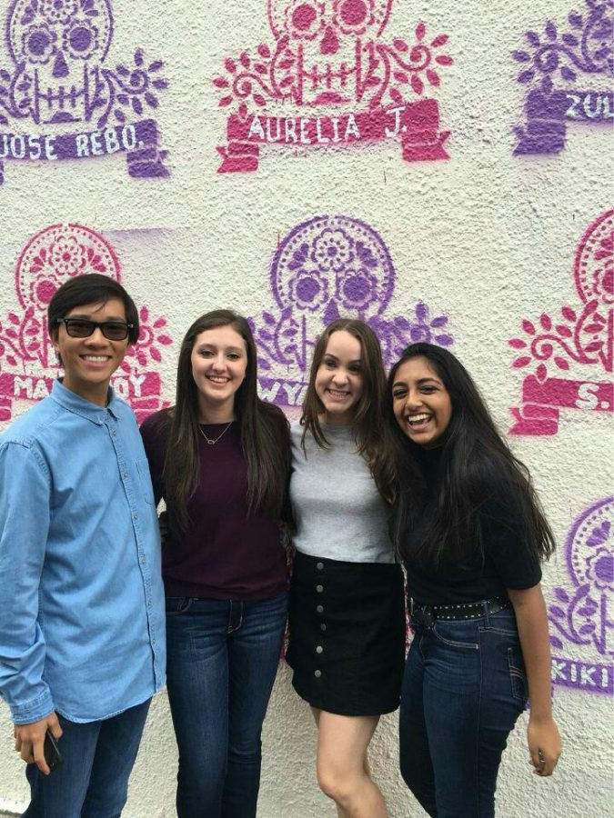 Spanish students stand in front of the painted mural on one of the Mexic-Arte's wall.