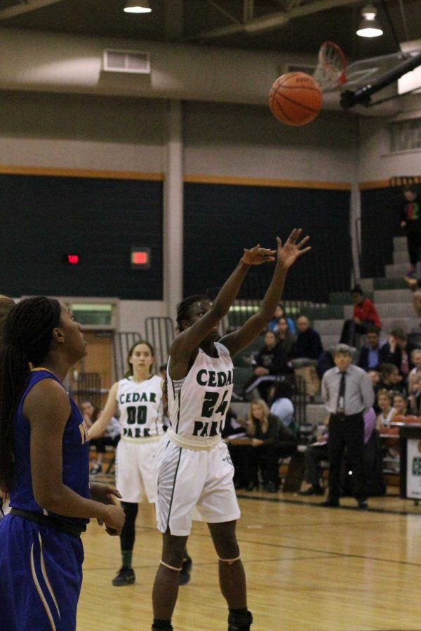 Senior+Chika+Onyia+shoots+a+free+throw+during+Cedar+Park%27s+game+against+Pflugerville+on+Nov.+8.