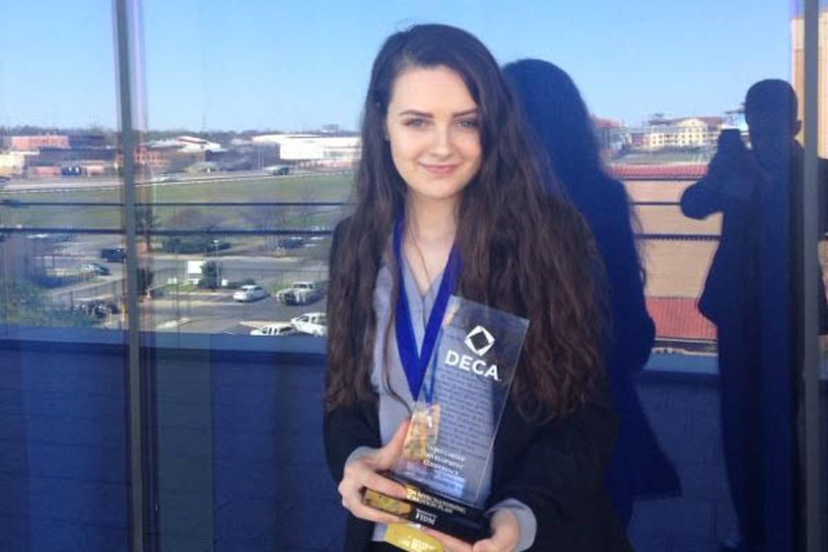 Senior Avery Daniel holding her award that allows her to advance on to Internationals in DECA.