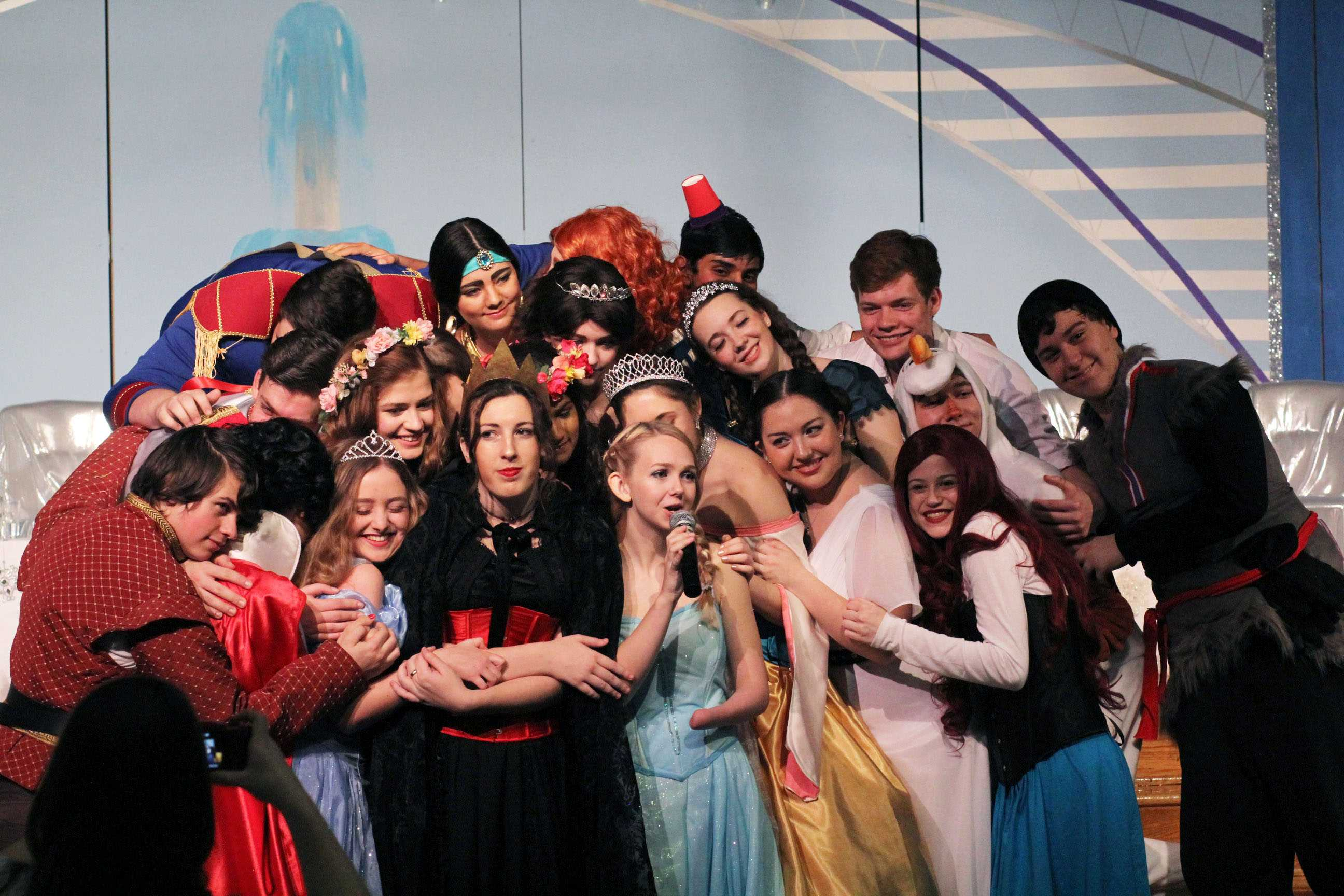 The cast of Princess Tea bringing it in for a group hug.