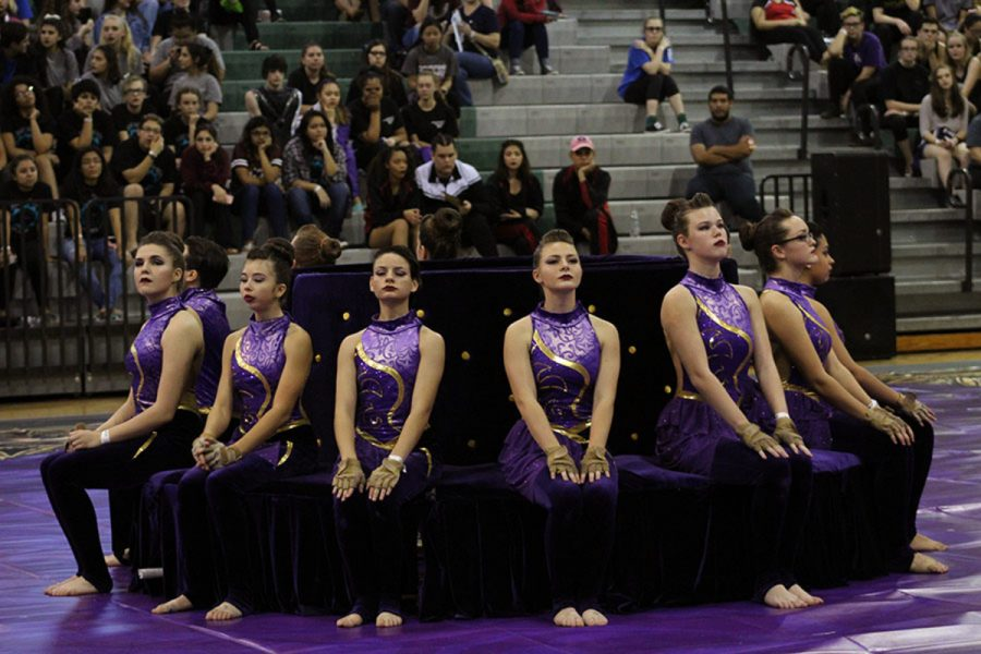 The+varsity+Color+Guard+wrapped+up+their+season+with+their+state+competition+on+Apr.+1.+It+was+their+first+year+competing+in+the+open+class%2C+and+they+took+home+a+sixth+place+trophy+for+the+school.+%E2%80%9CIt+felt+amazing+coming+off+the+floor%2C+knowing+that+we+did+our+best%2C%E2%80%9D+vice+president+of+administration+senior+Erin+Ryan+said.+%E2%80%9CIt+was+one+of+the+best+shows+we%E2%80%99ve+had.+It+was+kind+of+disappointing+that+we+didn%E2%80%99t+get+a+high+score%2C+but+we+did+pretty+well+knowing+that+the+others+have+been+competing+in+that+class+forever.+We+were+just+happy+with+our+team%E2%80%99s+performance.+It%E2%80%99s+always+the+last+show+that+you+remember+most%2C+and+I%E2%80%99m+glad+it+was+amazing.%E2%80%9D